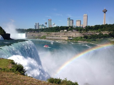 View of Canada from NY side of Niagara Falls with rainbow