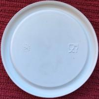 Weck canning jar lid in plastic, underside, shows dishwasher safe symbol