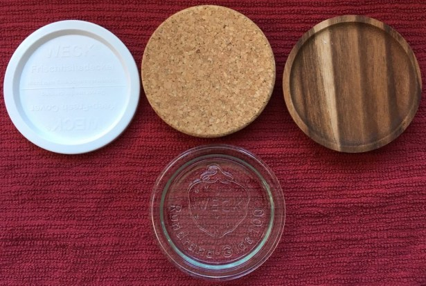 4 available Weck canning jar lids shown side by side: plastic, cork, wood, and glass