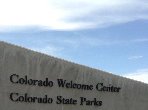Colorado Welcome Center, Fort Collins, sign under big blue sky