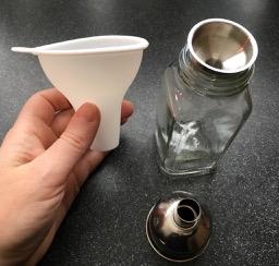 Funnels designed for filling flasks or oil jars are well sized to refill seasoning bottles