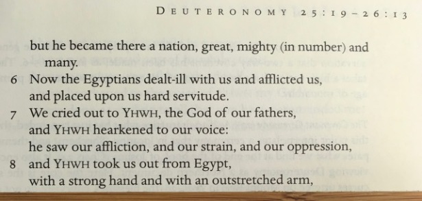 Bible open to show Deuteronomy 26:5-8 on the page
