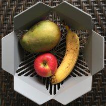 Mango, banana, and applie in fruit basket