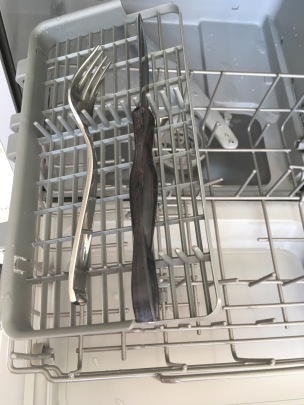 fork and steak knife on appliance's flat cutlery tray