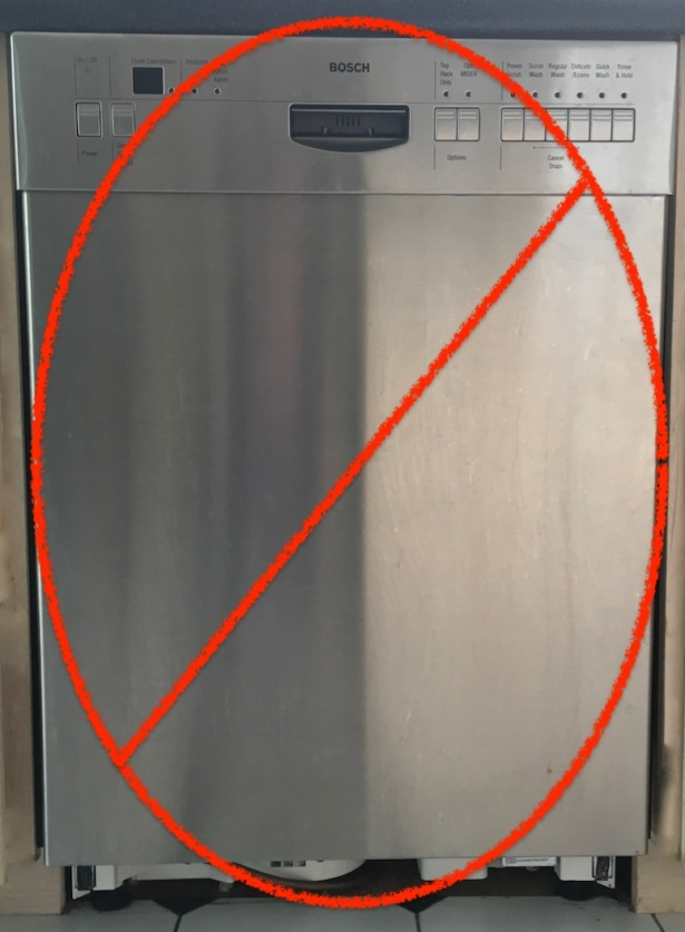 Red NO symbol crossing out broken stainless steel appliance