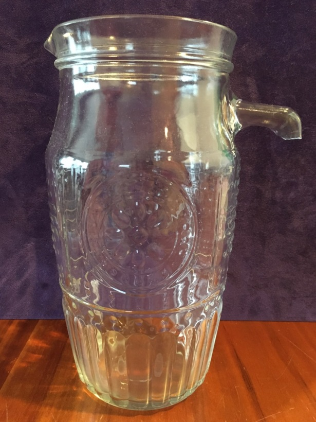 Patterned clear glass water pitcher with top stub only of broken off handle