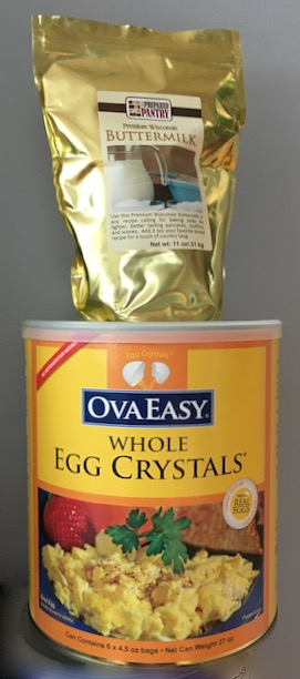 Bag of Buttermilk powder standing on large #10 can of OvaEasy Egg Crystals