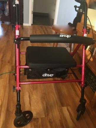 Red walker on hardwood floor in home